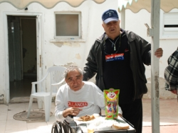 Jacques Cohen with handicapped Sderot resident