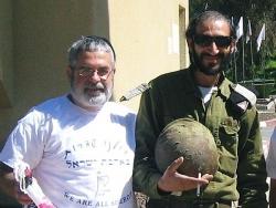 volunteer giving soldier mishloach manot
