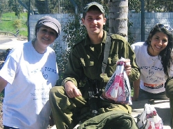 volunteers giving soldier mishloach manot