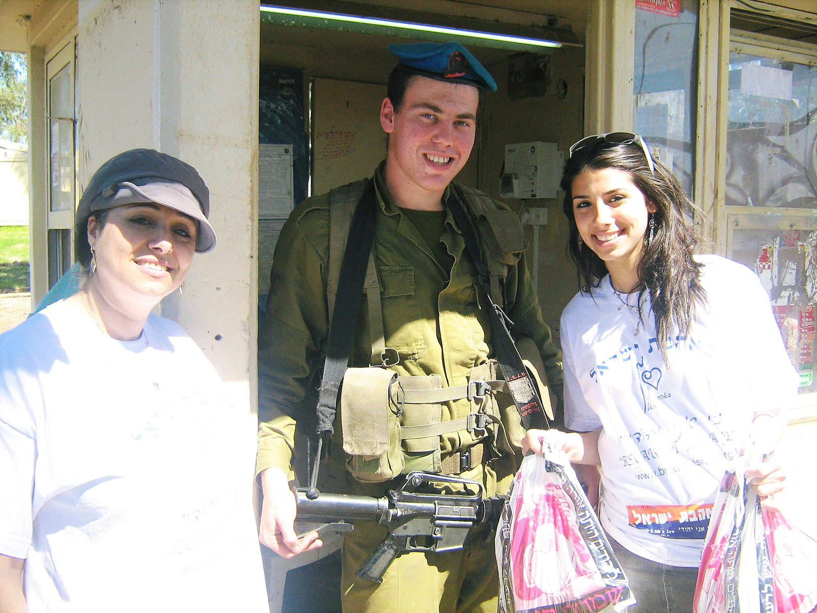 volunteers giving soldier mishloach manot
