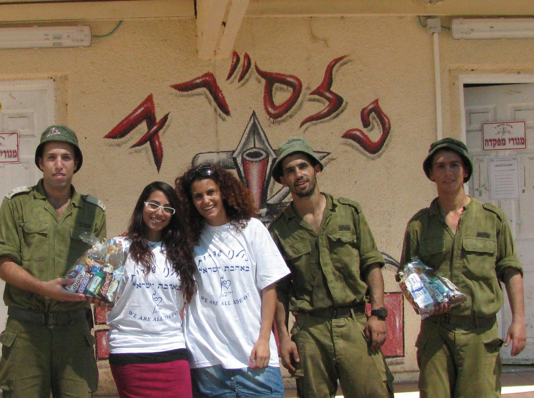 Volunteers distributing packages to soldiers