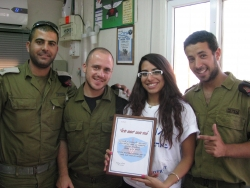 Receiving certificate of thanks from soldiers